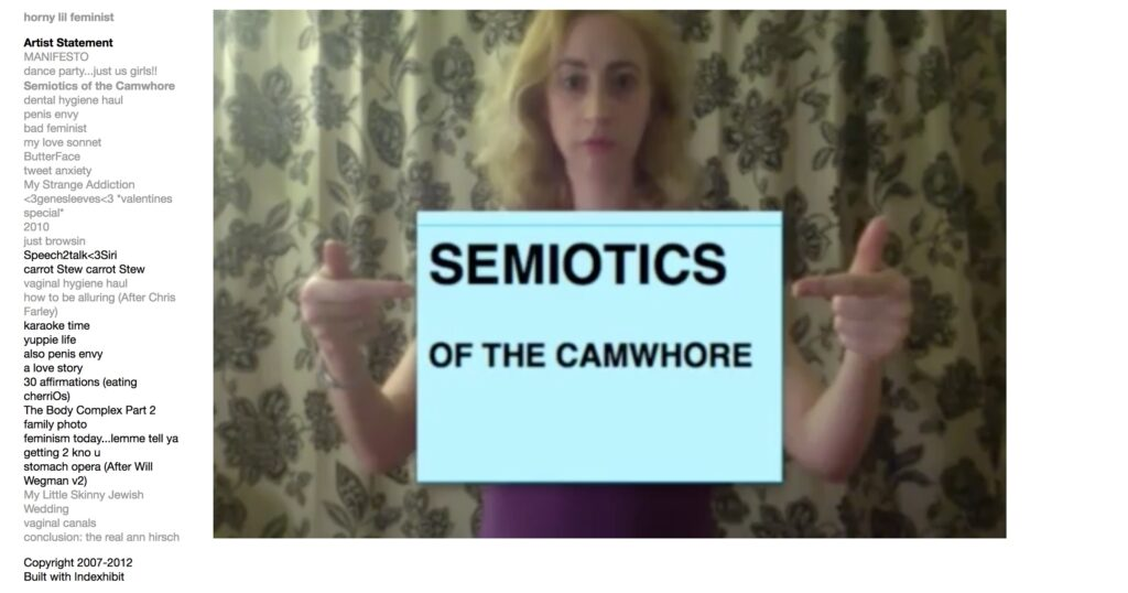woman poster that writes: semiotics of the cawhorelding a