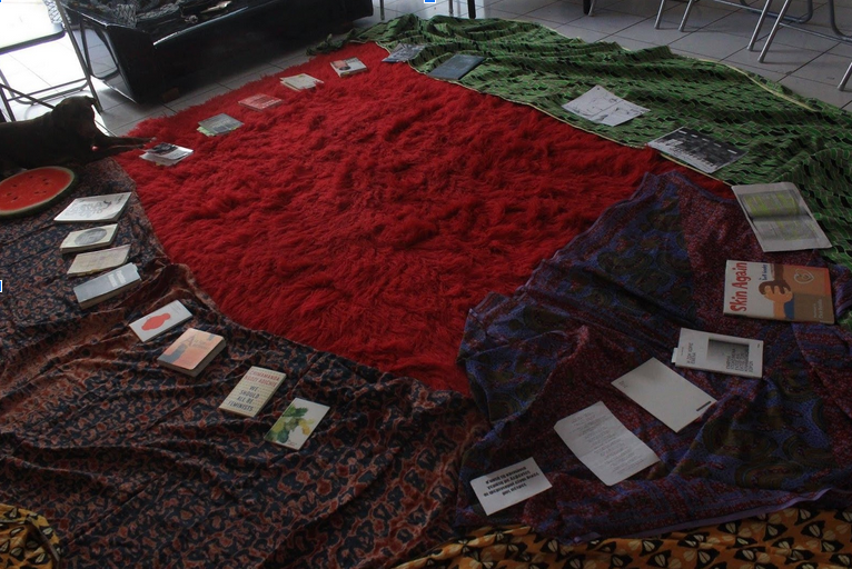 empty space with rugs and books